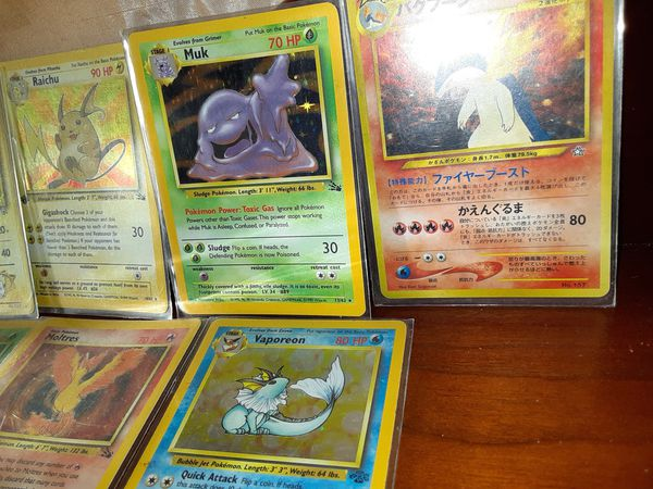Pokemon cards!!! Some of the holographic type 1st gen fossils very nice collection.