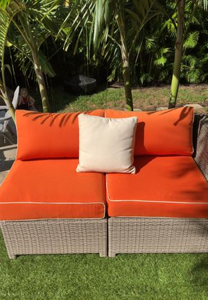 Nice 5.5 foot high end wicker sofa . Paid 699 will sell for only 350 with the Hermès orange custom cushions for Sale in West Palm Beach, FL