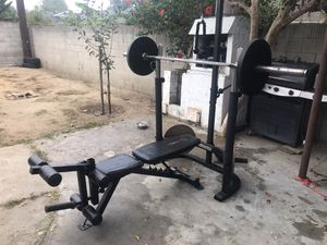 Bench Press with 45lb Olympic Weight Bar and Weights for Sale in Fountain Valley, CA