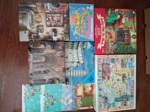 Puzzles, candle, small Christmas wrap, stuffed animals for Sale in Stafford, TX