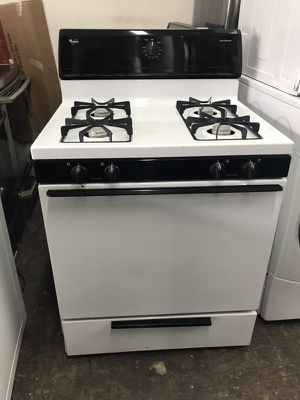 Whirlpool 4 burners gas range white and black! Frankford Appliances ! Warranty! We deliver!! .. for Sale in Philadelphia, PA