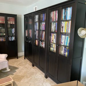 7 Like-New Ikea Dark Wood Bookshelves Book Cases With Glass for Sale in San Diego, CA