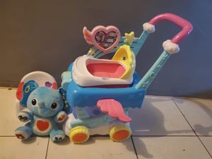 BABY DOLL WALKER, DOLL HIGH CHAIR AND A EDUCATIONAL ELEPHANT TOY for Sale in Miami, FL