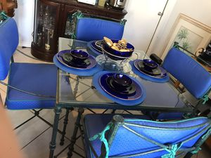 Dining Table and 4 chairs wrought iron/glass top and upholstered custom cushions for Sale in St. Petersburg, FL