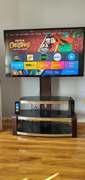 3teir glass entertainment stand and a 55 inch flat screen TV for sale works great for Sale in Spring Hill, FL