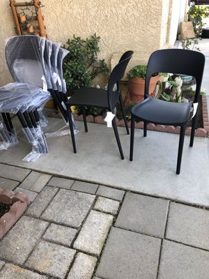 Brand new set of 6 contemporary hard plastic stackable chairs. Retails for over $360 for Sale in Fowler, CA