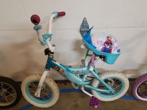 Frozen bike with helmet for Sale in Parkdale, OH