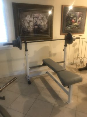 Weider International Olympic weight set 137.5lbs &7'Olympic barbell for Sale in Largo, FL