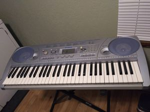 Yamaha keyboard with stand. for Sale in Seattle, WA