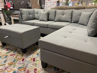 NEW IN THE BOX, Grey Sectional Large with Decorative Pillow, Ottoman storage Included. for Sale in Santa Ana,  CA