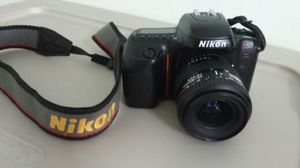 NIKON N50. AND LENS. FILM CAMERA. MINT COND. for Sale in Miami, FL