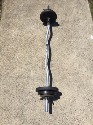 Standard curl bar with 40 pounds of metal weights for Sale in Philadelphia, PA