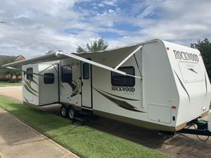 2012 Rockwood travel trailer all fiberglass to electric pushbutton slide outs fully loaded Electric awning for way leveling jacks Electric Jack fu for Sale in Cypress, TX