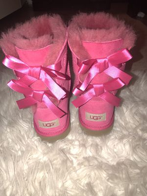Hot pink bow Ugg's for Sale in Boston, MA