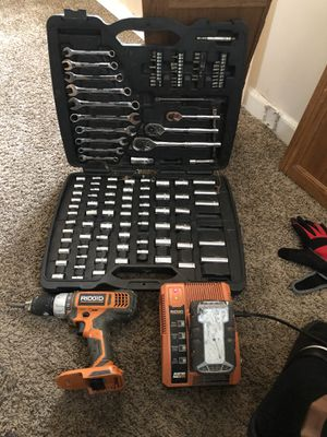 Rigid impact drill 18v with battery pack and charger and a socket wrench set for Sale in Detroit, MI