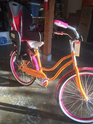 Schwinn women's bike 24 inch baby bike seat for Sale in Issaquah, WA