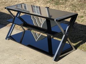 TV stand with glass and metal. 54Lx20Wx23H for Sale in Raleigh, NC
