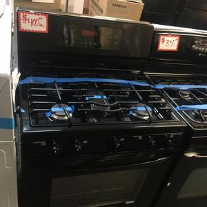 LG BLACK 5 BURNERS GAS STOVE IN EXCELLENT CONDITION 4 MONTHS WARRANTY for Sale in Laurel, MD