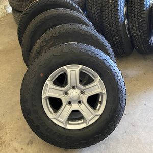 17' Factory Jeep Wheels And Tires for Sale in Cedar Creek, TX