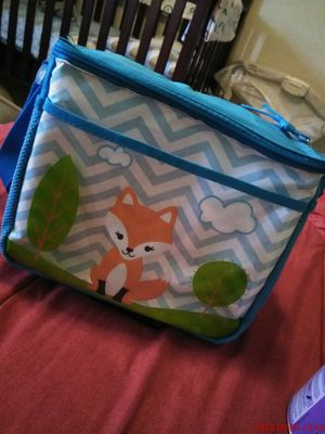 Mini diaper bag with Bag of newborn diapers inside for Sale in Dallas, TX