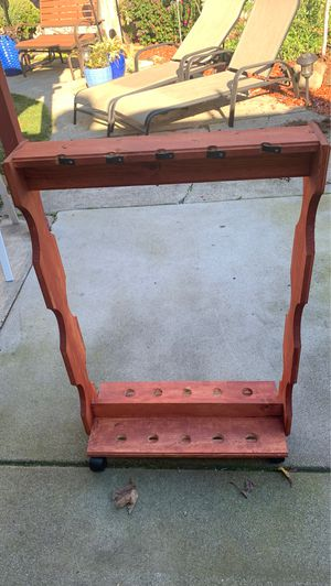 A rolling stain Fishing rack has holes for a ten poles for Sale in San Leandro, CA
