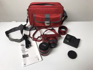 Nikon J1 camera complete w/ 2 interchangeable lenses(10-30mm & 30-110mm) lenses covers battery & charger, manual, usb cord, memory card, and Nikon ca for Sale in Bradenton, FL