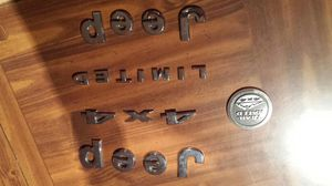 05 jeep grand cherokee emblems & rim center piece for Sale in Pittsburgh, PA