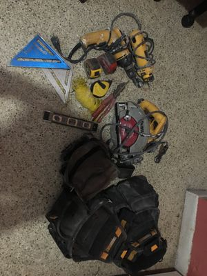 Tools and two belts with drills saws small level two measure tapes all for sale for Sale in Miami, FL