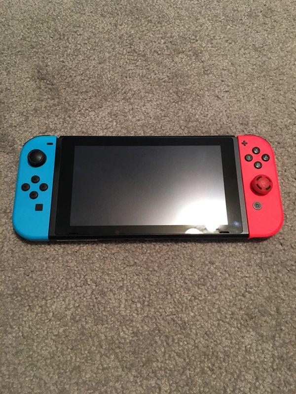 Nintendo Switch w/ Mario Kart 8 and 2 Wireless Switch Controllers