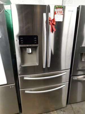 SAMSUNG STAINLESS STEEL 4 DOORS FRIDGE WORKING PERFECTLY 4 MONTHS WARRANTY for Sale in Baltimore, MD