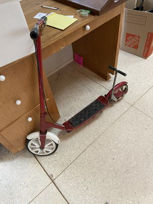 """Rare two wheeled """"Kick and Go"""" red scooter. Works perfect, even the breaks. 135lb weight limit. for Sale in Medina, WA"""