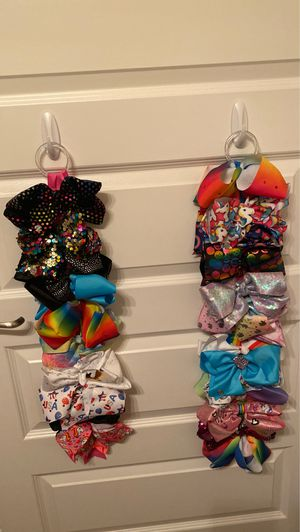 Jojo Bow Bundle with two holders. New/gently used for Sale in Orlando, FL