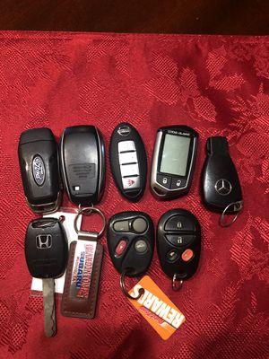 Key less entrys honda ford subaru nissan mercedes gms and code alarm for Sale in Dallas, TX