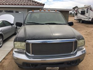 1999 f350 156k. Work truck. Engine and Transmission good. Truck has not been driven for more than 6 mons. Missing passengers side back fender. Back g for Sale in Phelan, CA
