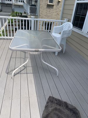 Glass patio table with 6 plastic chairs perfect for bbq for Sale in Gaithersburg, MD