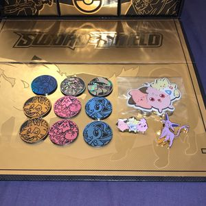 9 Pokémon Coins, 2 Pins And Small But Mighty Keychain for Sale in Tucson, AZ