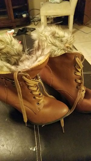 Charlotte russe size 7 fur lined boots for Sale in Brandon, FL