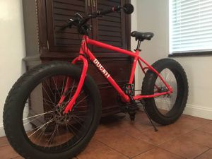 Ducati red with ducati decals Fat tire sand bicycle mountain bike front-disc brake speedometer comfort grips 8 speed excellent condition just dont us for Sale in Wilton Manors, FL