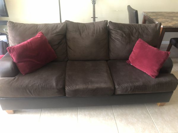 Brown and Leather Couch and Loveseat