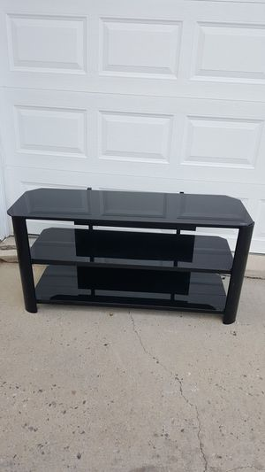 Black glass tv stand for Sale in Littleton, CO