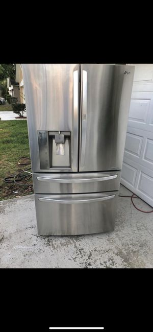 Lg refrigerator 4 door Stainless steel French style for Sale in Alafaya, FL