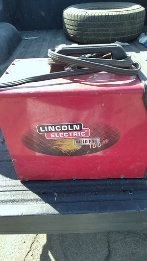 Lincoln electric weld pack hd 100 gas and regular welder with a miller mask and extra tips just missing the bolt and washer that hols the wire for Sale in Phoenix, AZ