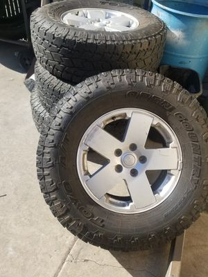 Toyo 285/75/18 35s with 5x5.5 jeep wheels for Sale in Poway, CA
