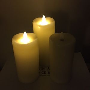 Set of 3 battery operated pillar candles. All 3 work, but one doesn't stay on, due to the button. Can probably be fixed, but I don't know how. for Sale in Vista, CA