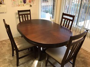 DINNING TABLE, OAK-MAHOGANY STAINED $300 AND (4) CHAIRS OF SAME MATERIAL $10 EACH for Sale in Rancho Cucamonga, CA