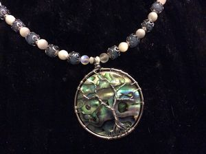 Tree of life abalone pendant on aquamarine, moonstones, Mother of pearl and labradorite beads with a sterling silver chain and adjustable clasp for Sale in Houston, TX