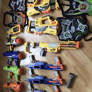 Lot of 11 nerf guns, vests, and bag of bullets for Sale in San Diego, CA