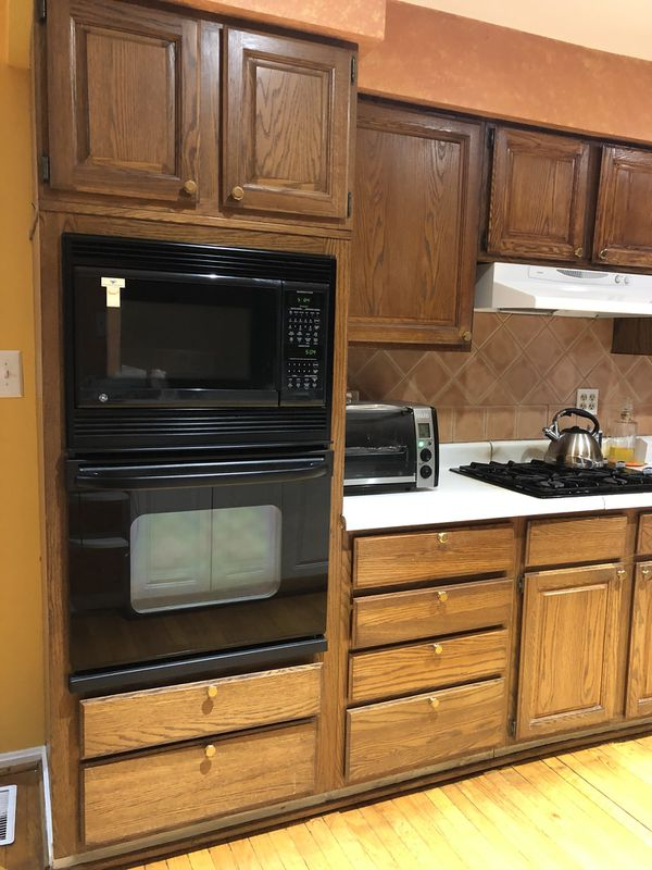 Kitchen Cabinets, oven, microwave, dishwasher, gas stovetop, and hood range