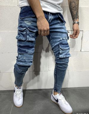 Men's blue cargo stretchy designer jeans store pick up limited sizes for Sale in West Hollywood, CA