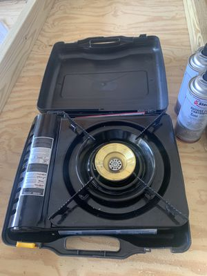 Portable cooking stoves, 4 8 oz cans of propane for Sale in Broadview Heights, OH